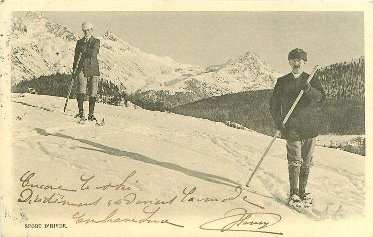 two men on skis face front, one casts a long shadow