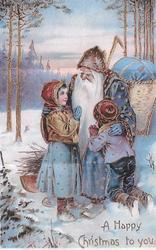 A HAPPY CHRISTMAS TO YOU  blue robed Santa sits on end of sleigh caressing boy & girl