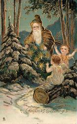 CHRISTMAS GREETINGS  brown robed Santa and two angels look at  Xmas tree