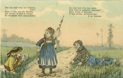 girl stands on road holding up furled parasol with her left hand, looking down at boy in ditch, another boy prone right