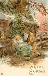 A HAPPY  CHRISTMAS, gold robed Santa  kneels by Baby Jesus in a cot