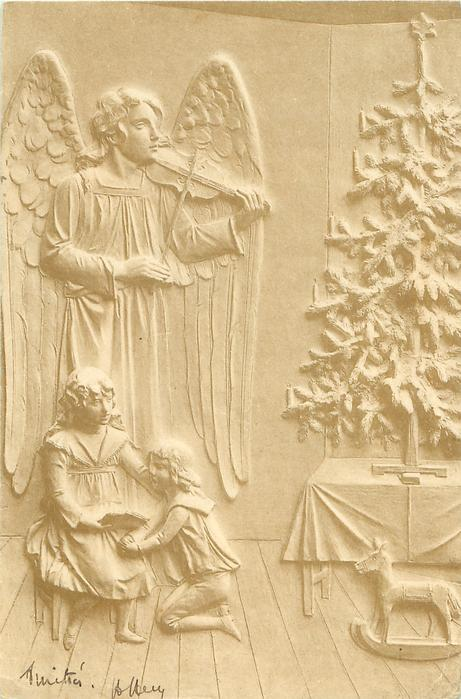 angel left plays violin, two  children on floor front left, Christmas tree standing on table right