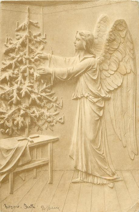 angel right, decorates Christmas tree standing on table