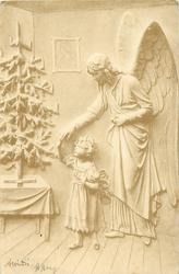 child touches angels hand as she looks up at Christmas tree standing on table