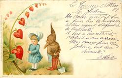 "dwarf holding spade behind his back talks to a girl in blue ""hearts"" growing left"