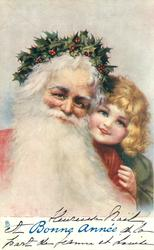 young girl looks over left shoulder of santa with flowing white beard & holly circlet on head