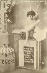 cupid sits on fireplace reading book A TOUTES LES JEUNES FILLES COQUETTES, BIJOUX, DENTELLES ET TOILETTES