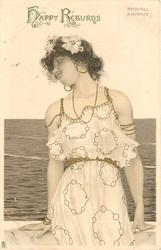 girl sits with back to sea, looking to left of card
