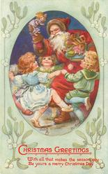 three children dance round Santa who holds up toys