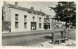 THE STOCKS AND DUN COW HOTEL  three people on street