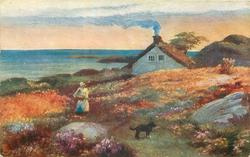 woman and dog on path between fields of flowers house behind right, sea to left