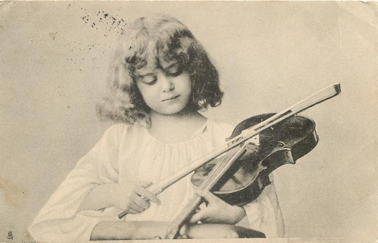 girl holds violin with fingerboard facing downward, she holds bow hairside up