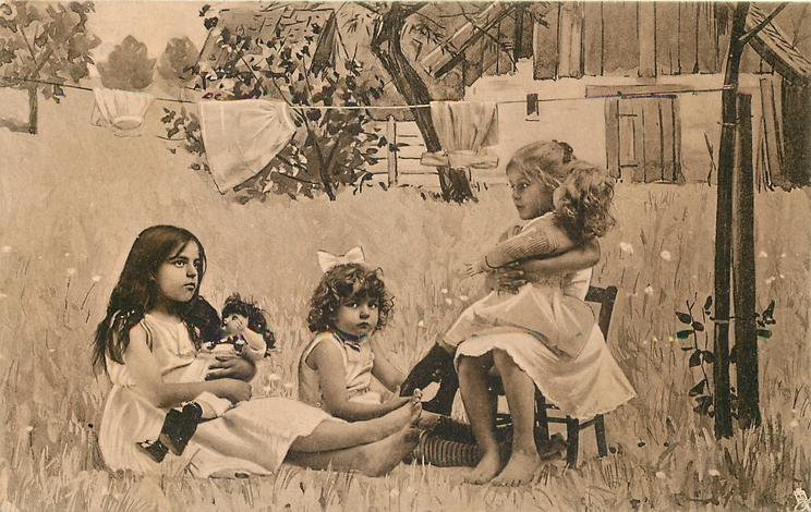 three girls play outside in country, girl on right seated in chair with large doll on her lap, others sit on grass, legs outstretched