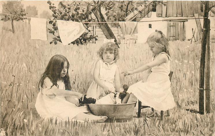 three girls pretend to bath doll in tin  tub, outside in country, girl on right seated in chair