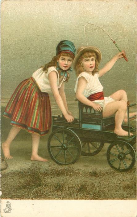 two bare-foot boy & girl on beach, smaller on old style child's carriage pushed from behind by the other