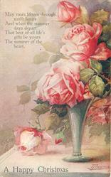 A HAPPY CHRISTMAS three pink roses in vase upright, one rose & bud hang down