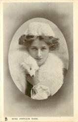 MISS PHYLLIS DARE, head and shoulders, wearing fur hat and fox fur scarf