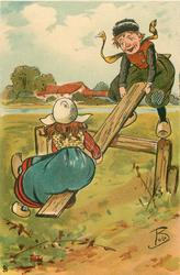 Dutch boy and girl on see-saw