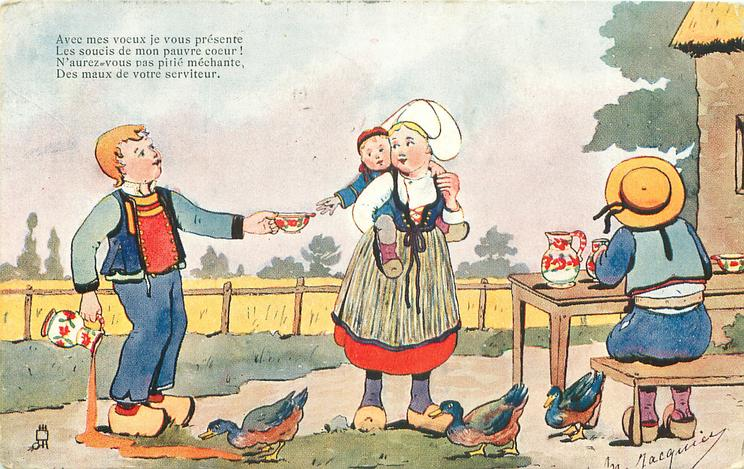four Dutch  children, boy left is pouring soup on the ground, holding cup out to baby carried piggy-back by girl, another child sits at table facing away, ducks below, verse AVEC MES VOEUX//SERVITEUR