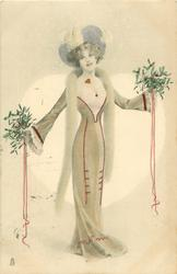 girl standing facing front holding mistletoe & ribbons in both outstretched hands