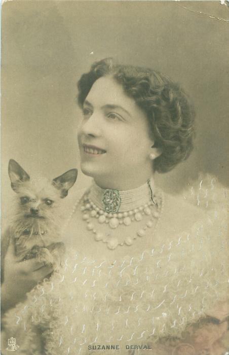 SUZANNE DERVAL holding small dog