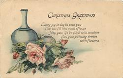 CHRISTMAS GREETINGS pink roses lay in front of two empty vases, one short & one tall