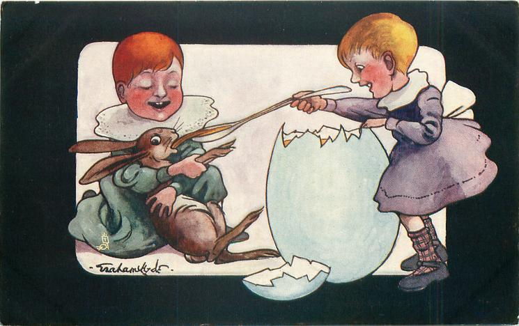 struggling rabbit held by boy is fed egg from long spoon held by girl across enormous egg shell