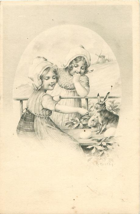 two Dutch girls, one on either side of rail, offer a flower to two rabbits