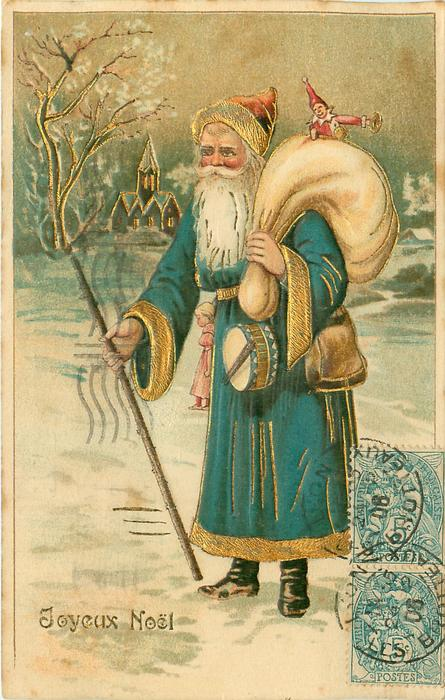 JOYEUX NOEL blue/green robed Santa stands in snow with sack over left shoulder staff in right hand