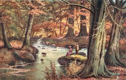 man and woman on riverbank, three deer opposite