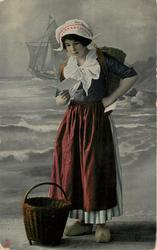 Dutch girl looks down at letter held with right hand, left hand on hip, red overskirt, with green stripes behind, bl/w  background of coast & sailing ship