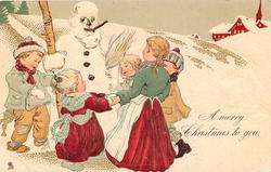 A MERRY  CHRISTMAS TO YOU, five children hold hands dancing round snowman holding his stave