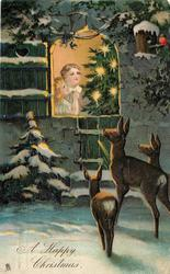 A HAPPY CHRISTMAS  three deer look in at two children & Xmas tree