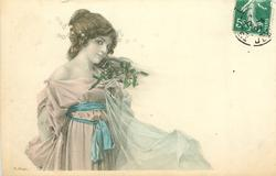 girl with short hair in off-shoulder dress faces right looks front holds mistletoe