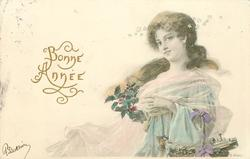 girl with long hair in off-shoulder dress faces left, looks front has holly in her lap, basket on her left arm