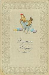 small brown hen with bluish legs faces left standing over five Easter eggs