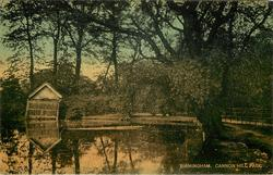 CANNON HILL PARK  pond with old boathouse behind, large tree to right