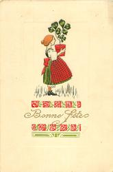 BONNE FETES girl stands facing right carrying pot of 3 & 4 leaf clovers, ornate design round title