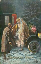 night snow scene, man assists woman in filmy dress & fur coat descend from antique car