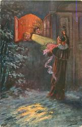 snow scene, woman bringing flowers knocks on door observed by two children in open lighted window