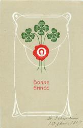 BONNE ANNEE red horseshoe in front of 3 4 leaf clover  stalks all framed in white design