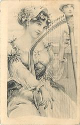 woman seated, playing harp