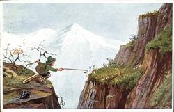 boy reaches across crevasse for flower, telescope and pack on cliff front left