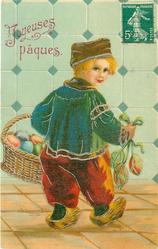 Dutch boy walks away with basket of Easter eggs on left arm, 3 more eggs dangle right