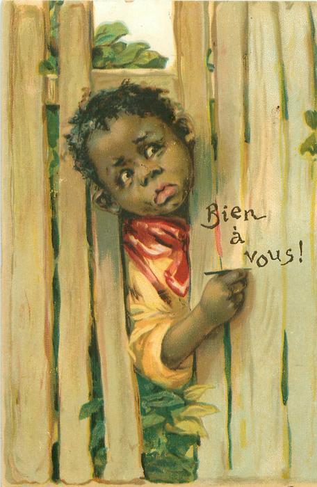 BIEN A VOUS!  black boy's head & shoulders through fence to write