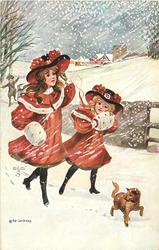 two girls follow little dog in snow