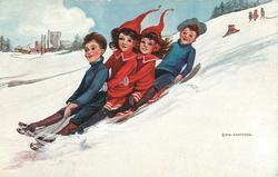 four children toboggan down snowy hill