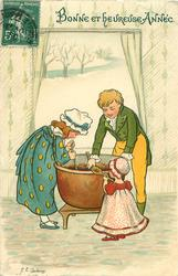 boy, girl and child stir large pot of Xmas pudding