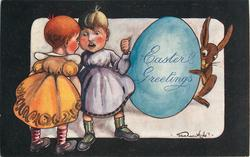EASTER GREETING  two children stand left, rabbit hides behing huge egg