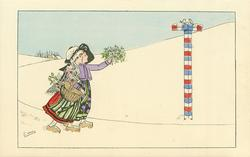 boy carrying mistletoe & girl carrying basket walk right towards tricolour painted signpost